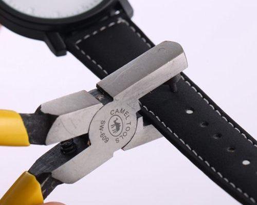 đục lỗ dây da đồng hồ